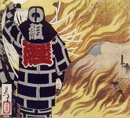 A flagbearer matoimochi holding tight to his pole as the fire rages around him