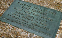 The plaque above the location where the car was buried.