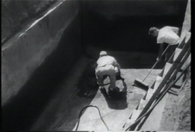 The men prepare the concrete vault